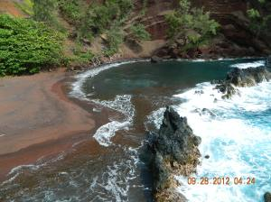 Arriving to the red sand beach. This is an amazing place worth the hike!