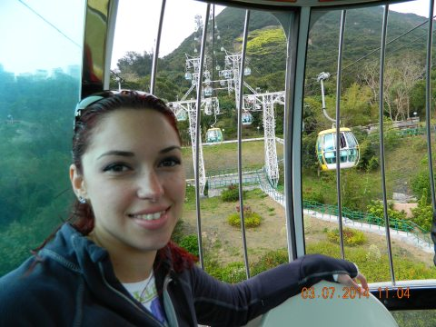 Riding the Tram on the way to the bigger rides on top of the mountain.